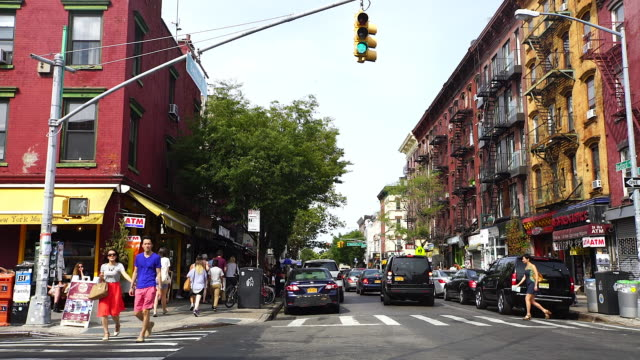 pan camera captures people and street view of bedford avenue at brooklyn. - avenue stock videos & royalty-free footage