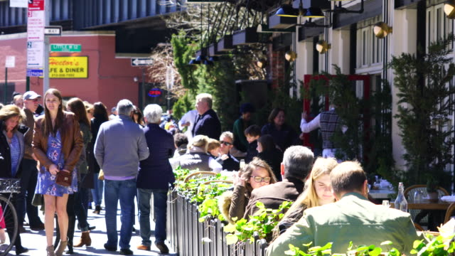 camera captures people, who are eating lunch at sidewalk tables of restaurant on washington street at meatpacking district in manhattan. - brunch stock videos and b-roll footage
