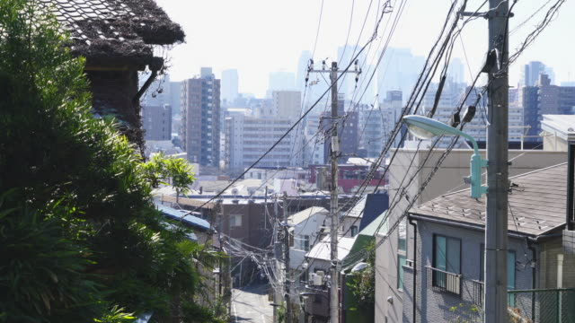 camera captures the cityscape of takada fujimizaka (fujimi slope) area, which was maintained in early showa period at takada toshima ward tokyo japan on feb. 03 2019. - narrow stock videos & royalty-free footage