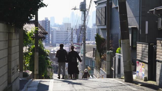 camera captures the cityscape of takada fujimizaka (fujimi slope) area, which was maintained in early showa period at takada toshima ward tokyo japan on feb. 03 2019. - narrow stock videos & royalty-free footage
