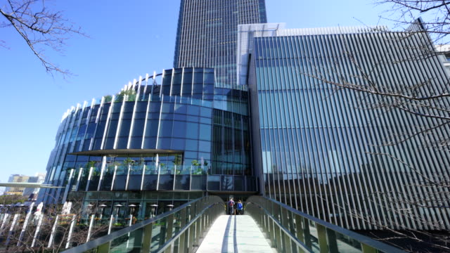 camera captures tokyo midtown architectures from connecting bridge in roppongi district at akasaka minato-ku tokyo. - tokyo midtown stock videos and b-roll footage