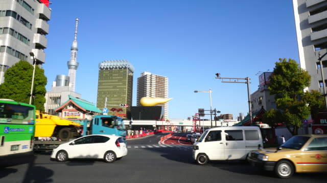 Camera captures traffic of Kaminarimon-Dori and Edo-Dori intersection in Asakusa, Taito-ku TOKYO. Tokyo Sky Tree and Asahi Beer Tower can be seen Behind Tokyo Expressway.