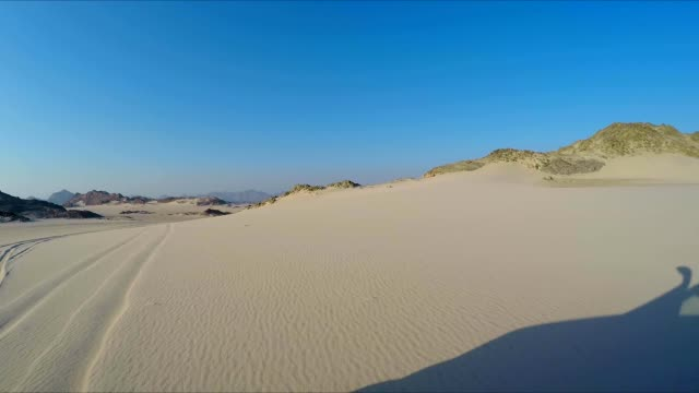 camera car  in the sand desert - tire track stock videos & royalty-free footage