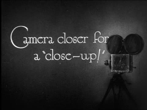 """b/w 1922 slate: """"camera closer for a 'close-up!'"""" / documentary - film slate stock videos & royalty-free footage"""