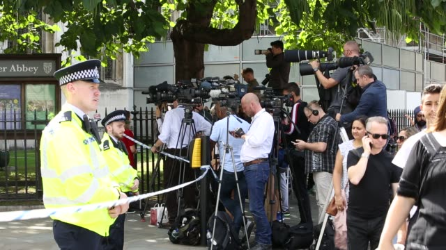 camera crews filming the aftermath of the latest incident where a man used a car to deliberately target pedestrians outside the houses of parliament... - photography themes stock videos & royalty-free footage