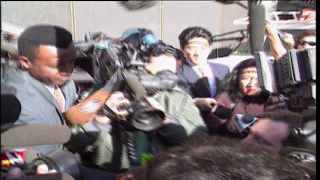Camera crews from different channels are following Madonna's lawyer Nicholas DeWitt after the first day of the trial against her stalker Robert Dewey...