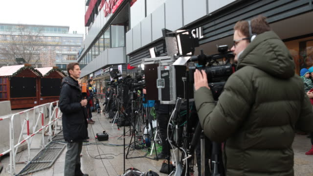 camera crews report at breitscheidplatz on the attack's first anniversary on december 19, 2017 in berlin, germany as well as christmas market stalls.... - terrorism stock videos & royalty-free footage