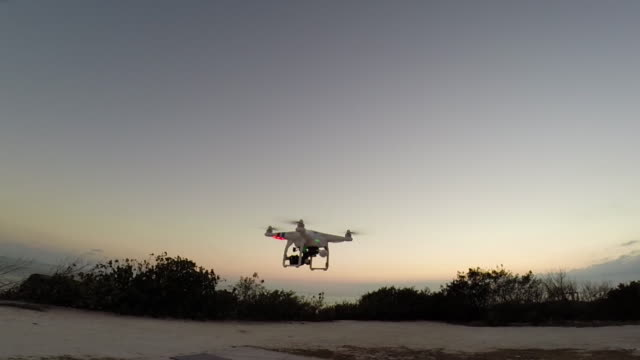 A camera drone flying at sunset. - Slow Motion