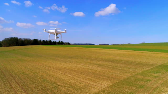 camera drone flying in open country - hovering stock videos & royalty-free footage