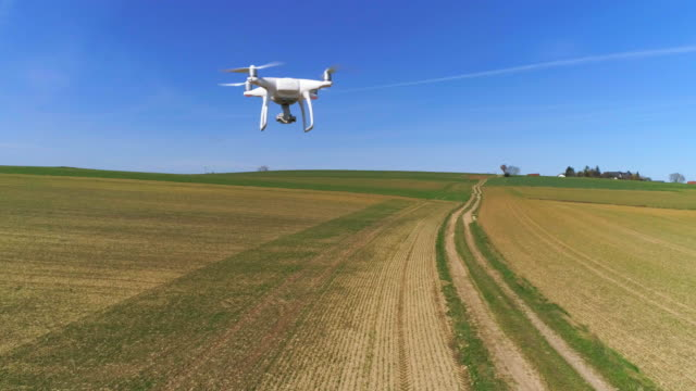 camera drone flying in open country - autonomous technology stock videos & royalty-free footage