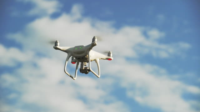 vídeos y material grabado en eventos de stock de camera drone hovering and turning in the sky (4k/uhd) - big brother