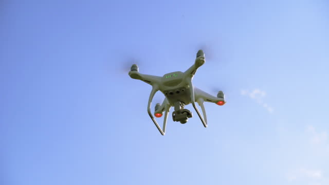 camera drone hovering in the sky - hovering stock videos & royalty-free footage