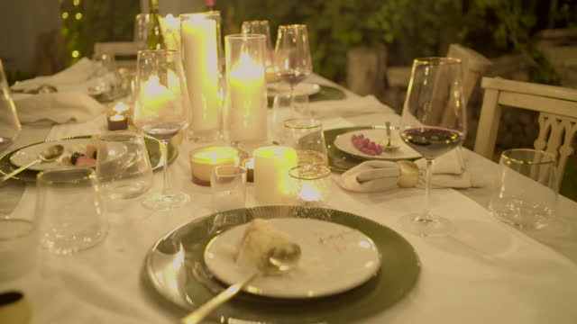 a camera explores a dining table at night - overexposed stock videos & royalty-free footage