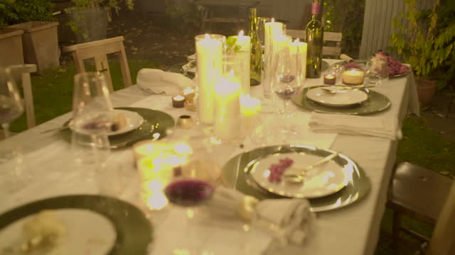 camera explores an empty dinner table - overexposed stock videos & royalty-free footage