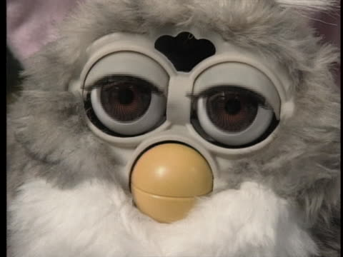 stockvideo's en b-roll-footage met camera films a group of animated furbies on display. two of the popular toys are shown speaking to each other. - music or celebrities or fashion or film industry or film premiere or youth culture or novelty item or vacations