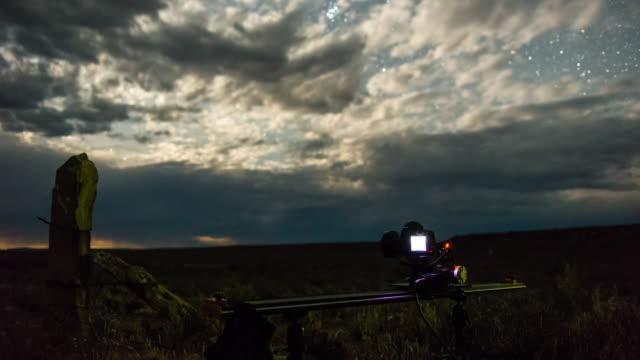 a camera films a timelapse shot of dramatic clouds rolling over a karoo landscape - karoo bildbanksvideor och videomaterial från bakom kulisserna