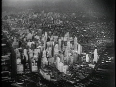1952 AERIAL Camera flying over New York City and circling Empire State Building / New York, United States