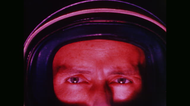camera focuses on the astronauts' eyes as the narrator questions man's need to explore space - alan b. shepard jr stock videos & royalty-free footage
