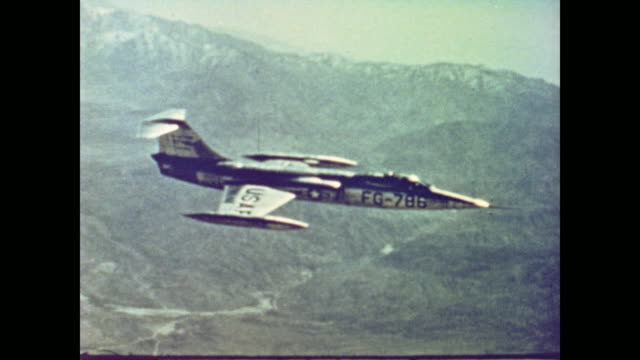 camera follows a republic f105 thunderchief plane a lockheed f104 starfighter plane across the sky as narrator plays up the strength of the american... - us airforce stock videos & royalty-free footage