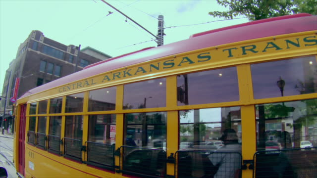 camera follows downtown little rock trolley, central arkansas transit - arkansas stock videos & royalty-free footage