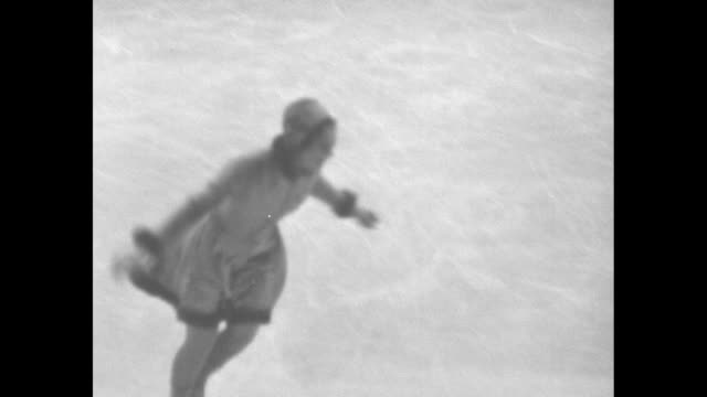 camera follows sonja henie as she figure skates at 1932 winter olympics; she skates past perry dring and his orchestra playing on the ice and other... - bass guitar stock videos & royalty-free footage
