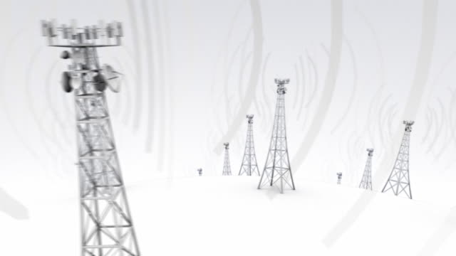 camera glides horizontally past cell towers emitting waves on a globe - repeater tower stock videos and b-roll footage