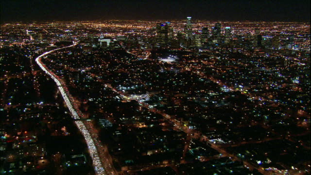 Camera glides towards downtown LA skyscrapers; 101 fwy in left frame.