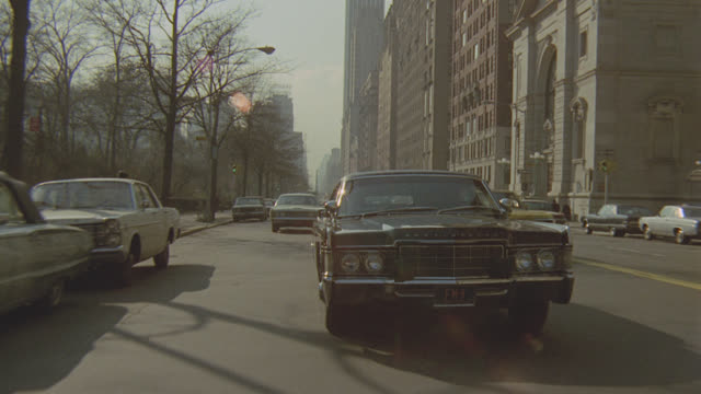camera leads black lincoln continental limo in new york city traffic - limousine stock videos & royalty-free footage