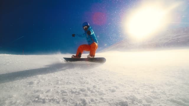 speed ramp camera lens being splashed when snowboarder rides through powder - agility stock videos & royalty-free footage