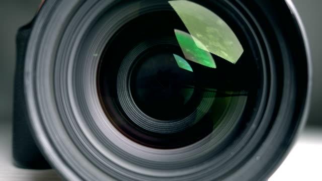 vidéos et rushes de appareil photo objectif, photographier - ouverture du diaphragme