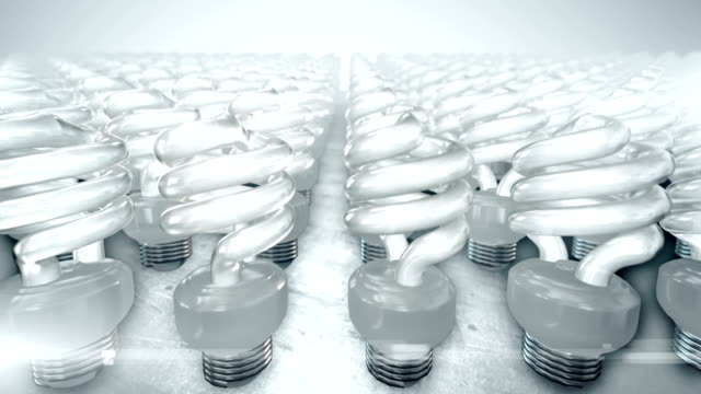 Camera movement over group of energy saving lightbulbs (bright)