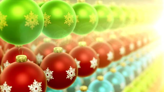 Camera movement over multi-colored christmas ornaments