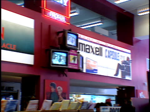 camera moves through the aisles of tower records as people browse the shelves for music - compact disc stock videos & royalty-free footage