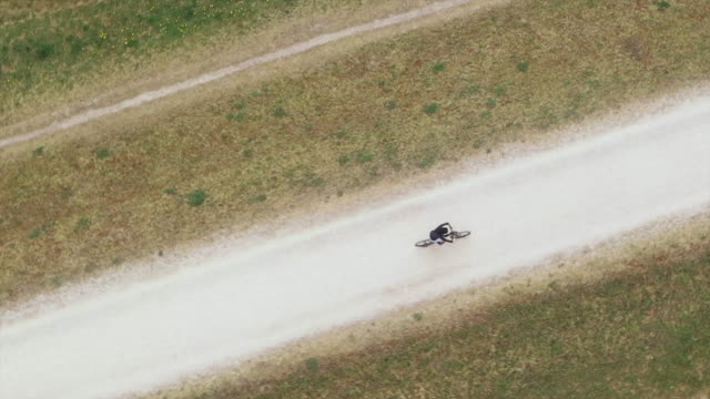 camera moving around boy cycling on a trail, aerial view - 8 9 years stock videos & royalty-free footage
