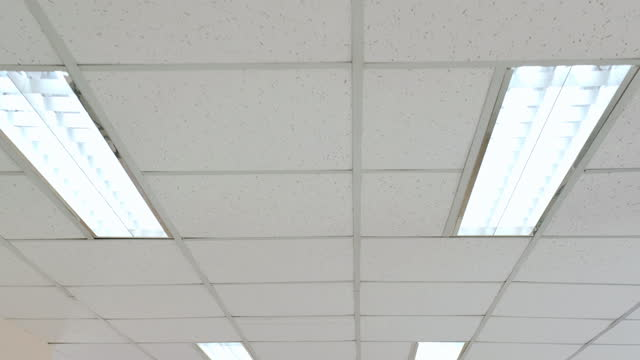 pov :camera moving end of white ceiling with neon lights in the office or hospital.find & replace, hospitals concept. - fluorescent stock videos & royalty-free footage
