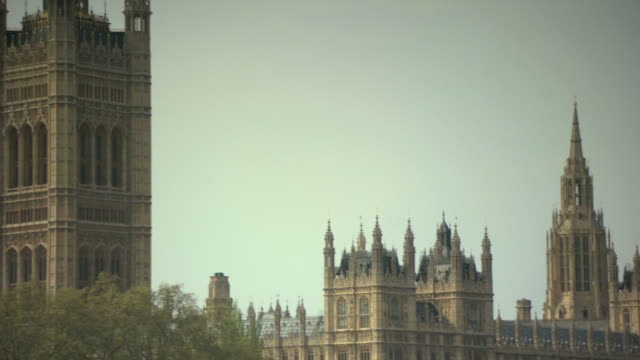 Camera moving from view of victoria tower towards big ben at houses of parliament