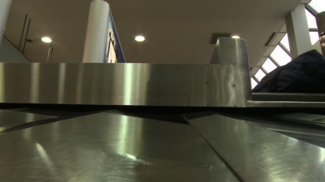 Camera on the baggage claim conveyor.