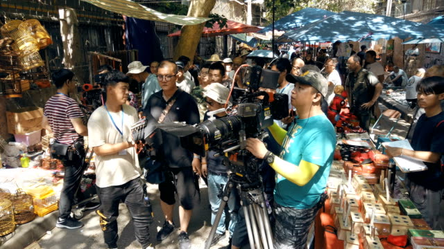 camera operator is shooting the scene on street,xi'an,china. - film industry video stock e b–roll