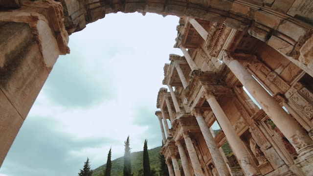 Camera pan around ancient architecture in Library of Celsus wide angle