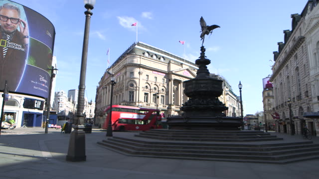 camera pan establishing shot of a nearly empty piccadilly circus during the covid19 pandemic in london england - fountain stock videos & royalty-free footage