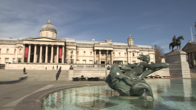 camera pan establishing shot of a nearly empty trafalgar square during the covid-19 pandemic in london, england. - healthcare and medicine or illness or food and drink or fitness or exercise or wellbeing stock videos & royalty-free footage