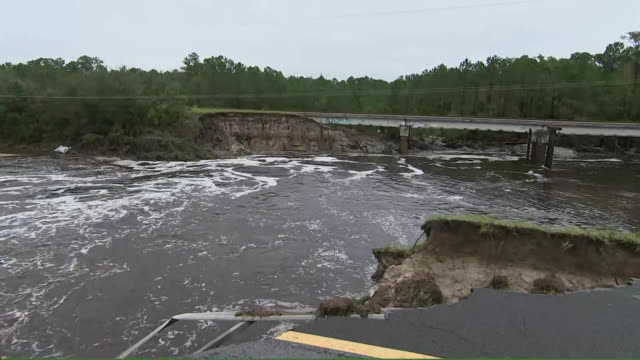 camera pan of the sanford dam breach in the aftermath of hurricane florence on september 16, 2018 in boiling spring lakes, north carolina. - environment or natural disaster or climate change or earthquake or hurricane or extreme weather or oil spill or volcano or tornado or flooding点の映像素材/bロール