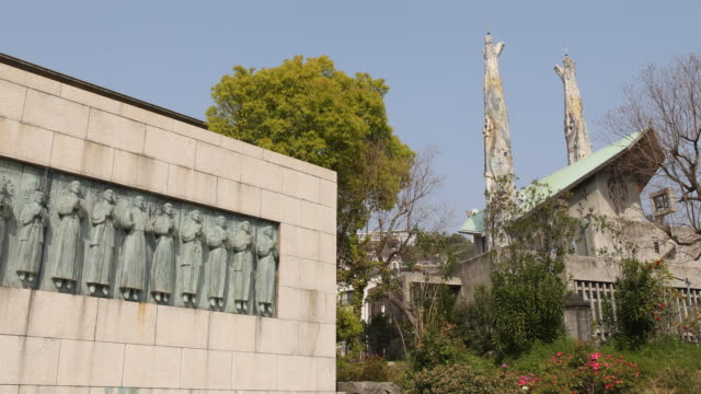 A camera pan to the left showing the TwentySix Martyrs' monument and Nishizaka church at the TwentySix martyrs museum in Nagasaki Japan The museum...
