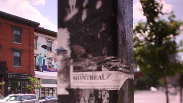 camera pans across lamp post to reveal mary poppins mural in montreal - montréal stock videos & royalty-free footage