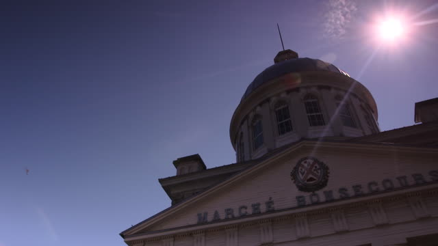 camera pans across silver dome roof of marche bonsecours in old montreal, canada - vieux montréal stock-videos und b-roll-filmmaterial