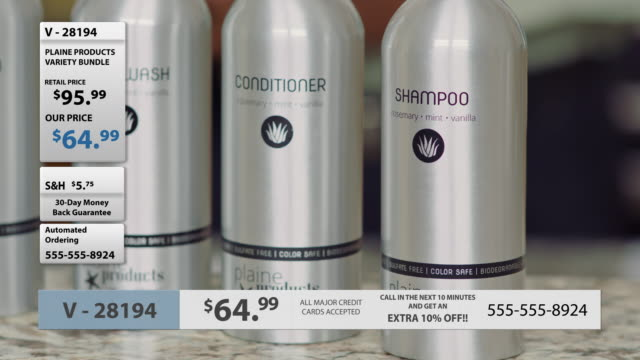 camera pans left and right across aluminum bottles of eco-friendly shampoo, conditioner, body wash and lotion in television infomercial. - beautification stock videos and b-roll footage