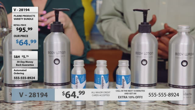 camera pans right over a variety of body lotions, shampoos, and conditioners on television infomercial. - hair conditioner stock videos and b-roll footage