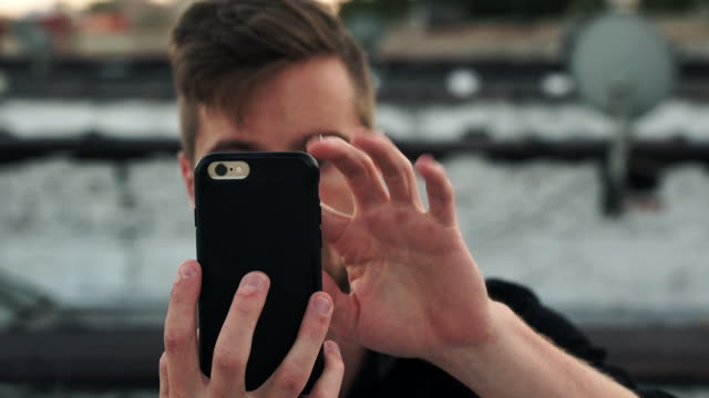 camera phone - closeup - one mid adult man only stock videos & royalty-free footage