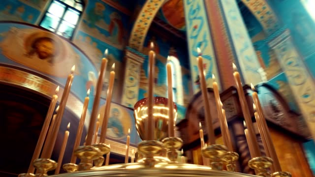 camera rotation around candle on candlestick holder in church - group of objects stock videos & royalty-free footage