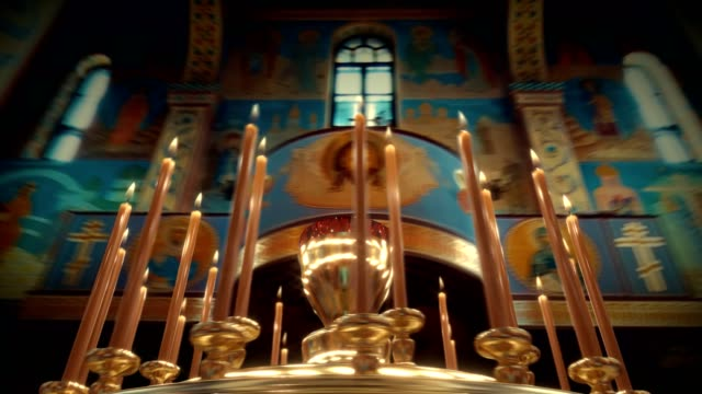camera rotation around candle on candlestick holder in church - ceremony stock videos & royalty-free footage